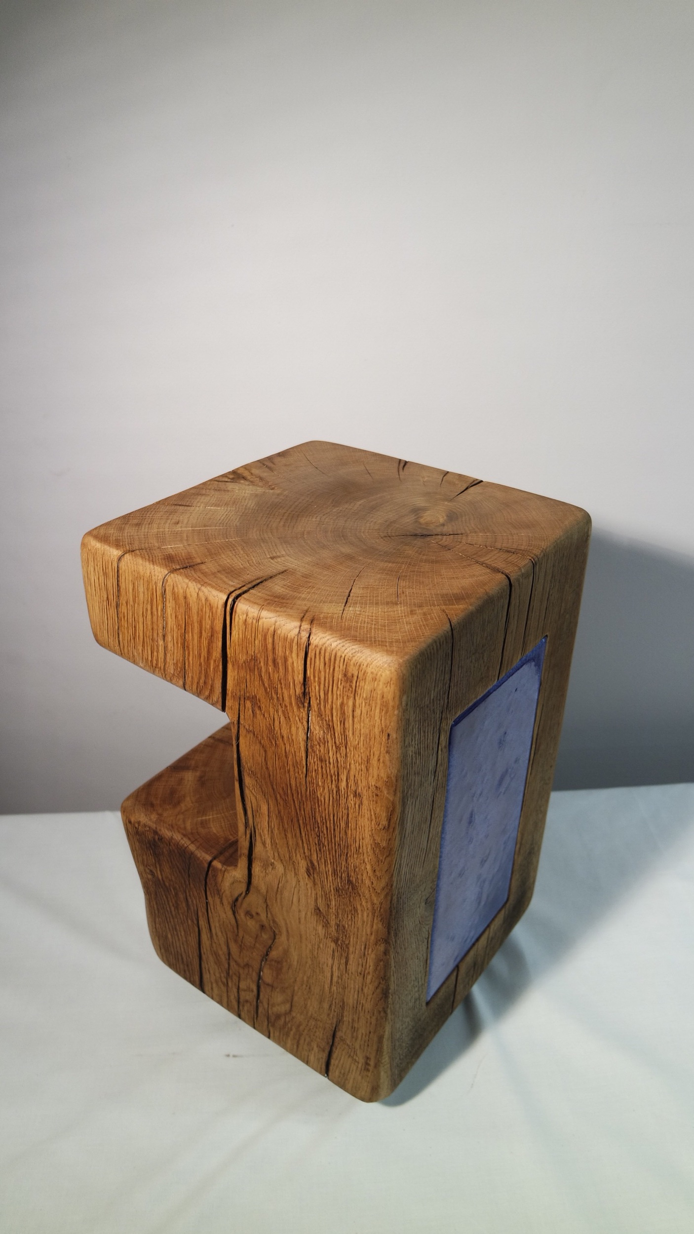 Oak side table showing the hand made blue glass insert