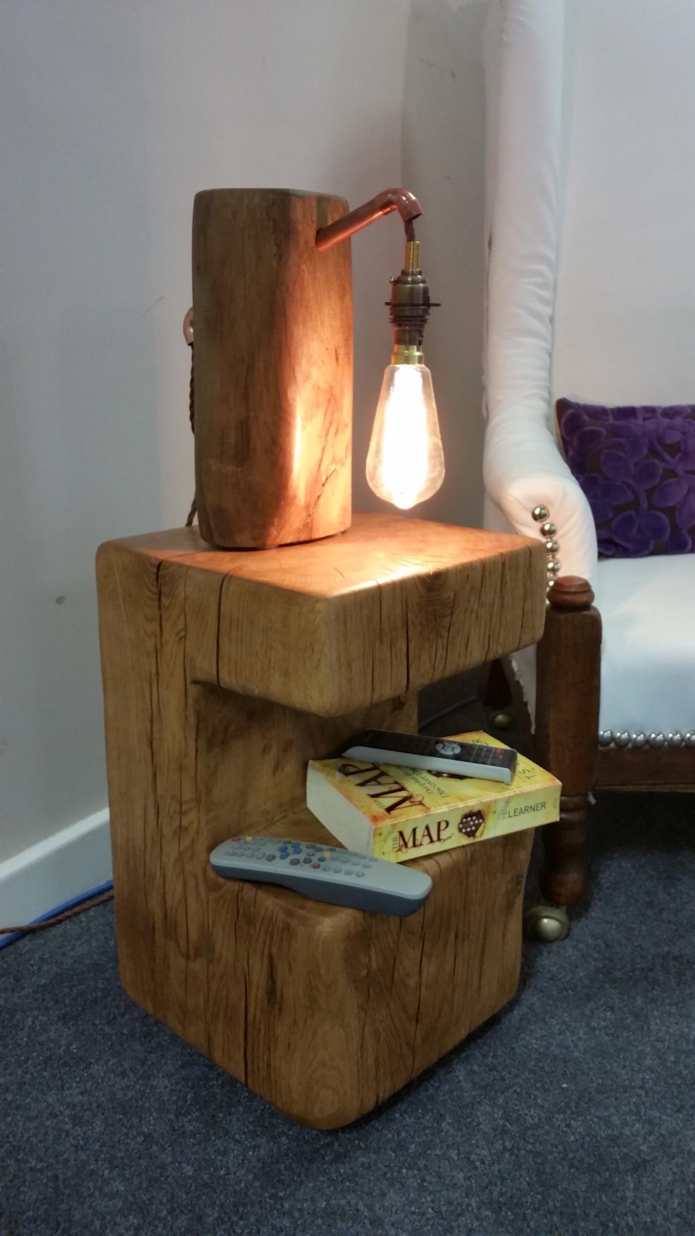 Oak side table with cut away storage shelf