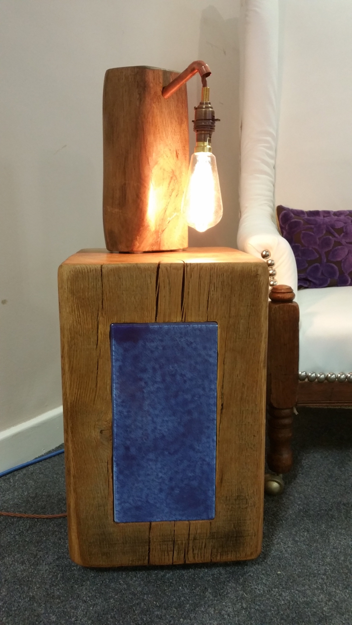 Front view of the oak side table with blue glass  insert