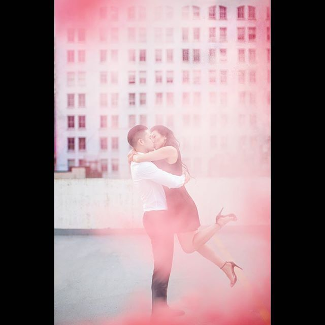 Aaron & Lisa were up for anything we wanted to do, so we did it all including this rooftop photo session. ❤️ - Although right now we're really starting to miss the clean BC air and blue skies, keep your heads up guys the good news is rain is on its way this Sunday!!! Shot on Canon 5D MKIII 85mm 1.2 with the help of @henrydop.co blasting a 2 minute red smoke grenade from @gorillasurplus1968 🚀