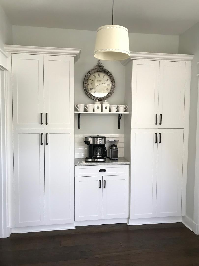 We used an awkward space next to the kitchen to create a functional pantry/coffee bar.