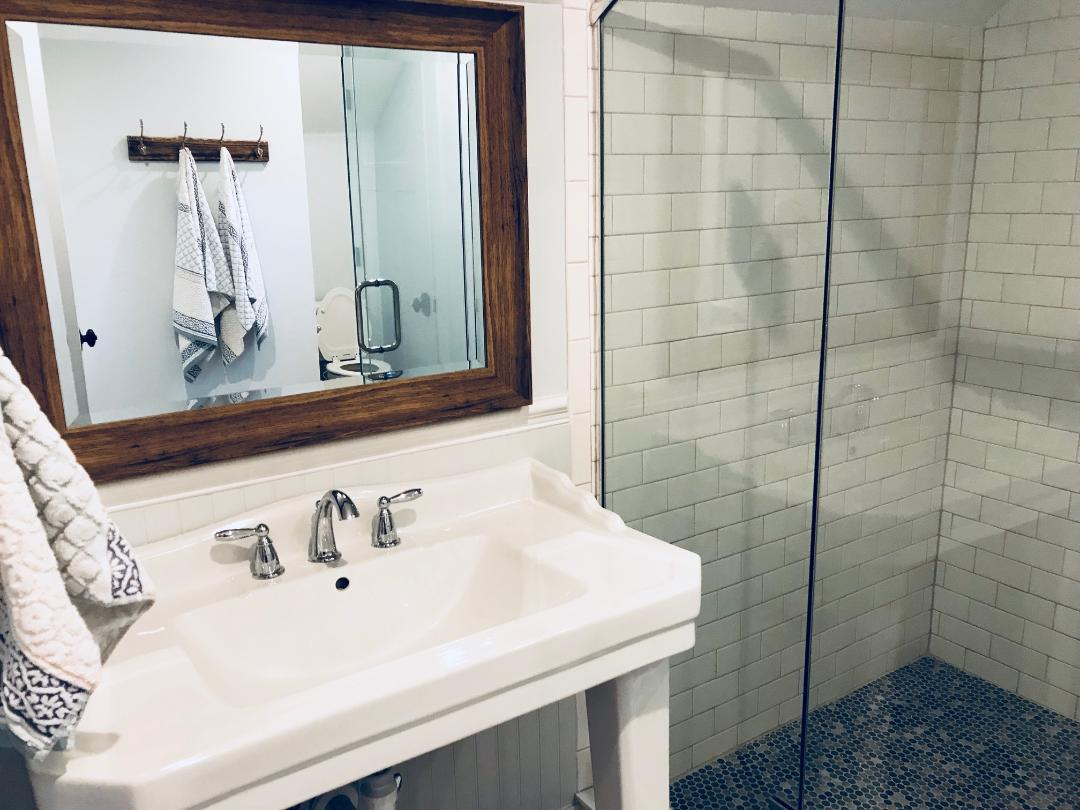 Subway & Penny Tile: Another common tile trend in the early 1900's was white subway tile walls and penny tile floors. Which is why we decided to use the classic look in our master and guest bathroom.