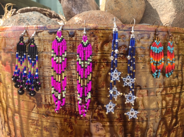 Beaded Jewelry by Allie Raven - Allie is a member of the Bad River Bad of Lake Superior Chippewa. She started beading when she was a little girl. Building on traditional beadweaving techniques, Allie creates lively color combinations inspired by our natural surroundings: sparkling waters, trees and sandy shores, berries under deep green leaves, the coppery cliffs rising along the Lake's south shore.