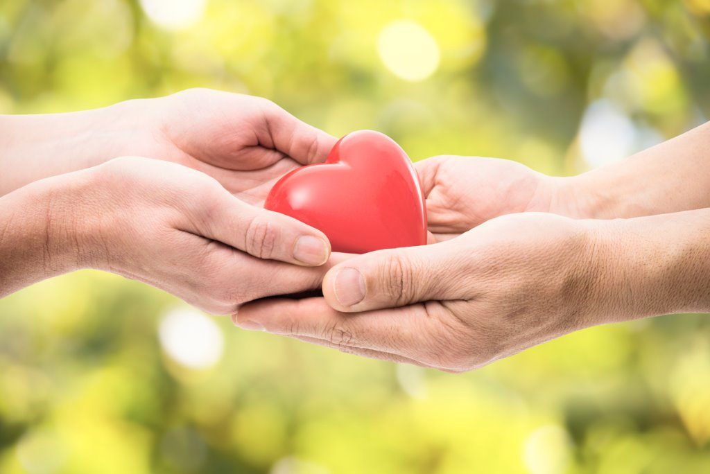 red-heart-in-human-hands-picture-id467661889.jpg