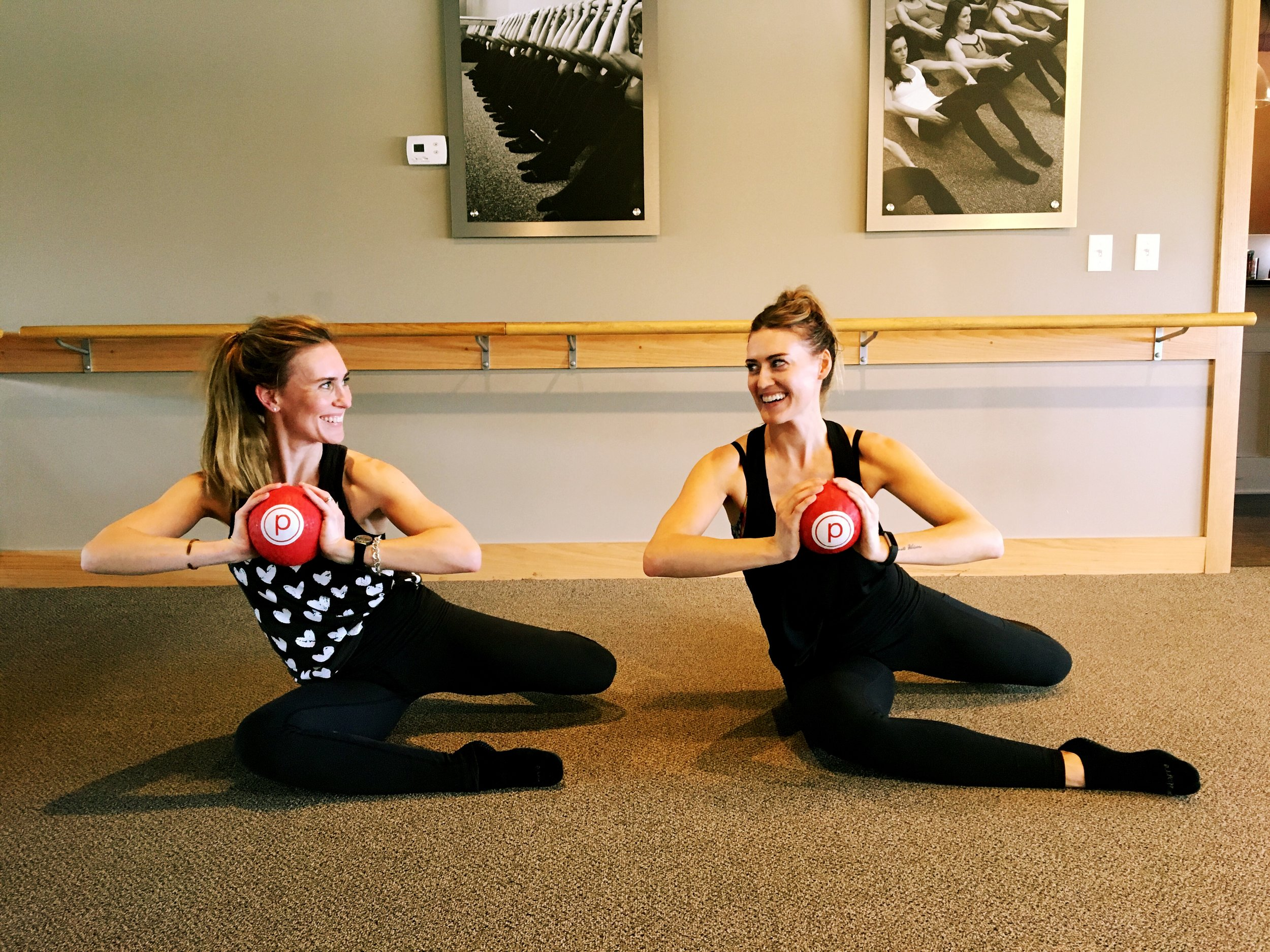 Kady Decker (right) practicing Pure Barre with her sister.