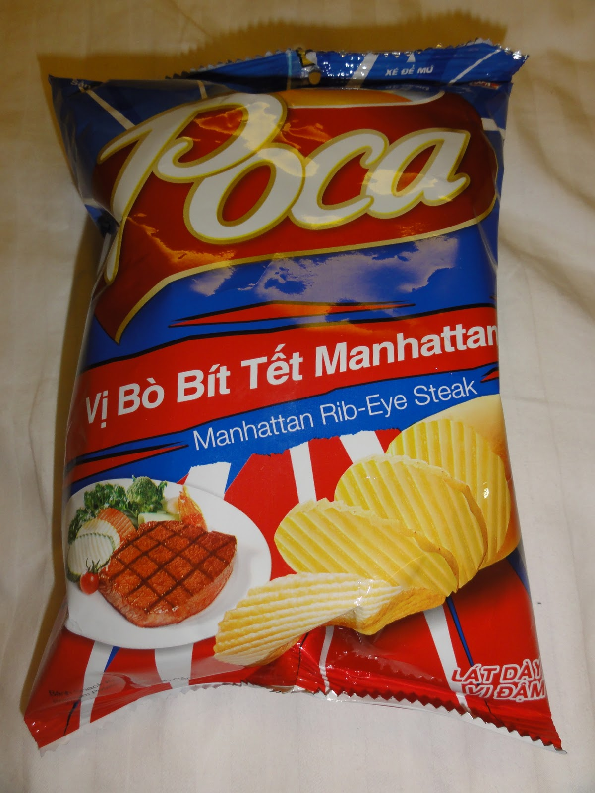 """Poca's """"Manhattan Rib-Eye"""" flavored chips taste like a narrow escape from death's clutches, far from home. -"""