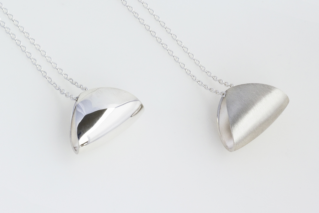 Image: Small Puff Pendant in brushed and high polish finish, a highlight of the puffed collection.