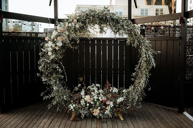 Our gold hoop arch looking stun covered in forals.⠀ ⠀ Photographer : Zanda Photographer IG  @zanda_photography  Planning & Styling: Boheme Events IG @boheme.events ⠀  Venue: Chancery Chambers Rooftop Venue IG @chancerychambersrooftopterrace ⠀  Florist: Honey Suckle Flowers⠀ IG @honeysuckleflowers