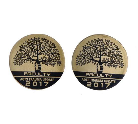 Rueda-Badge-engrave-awards-more.jpg