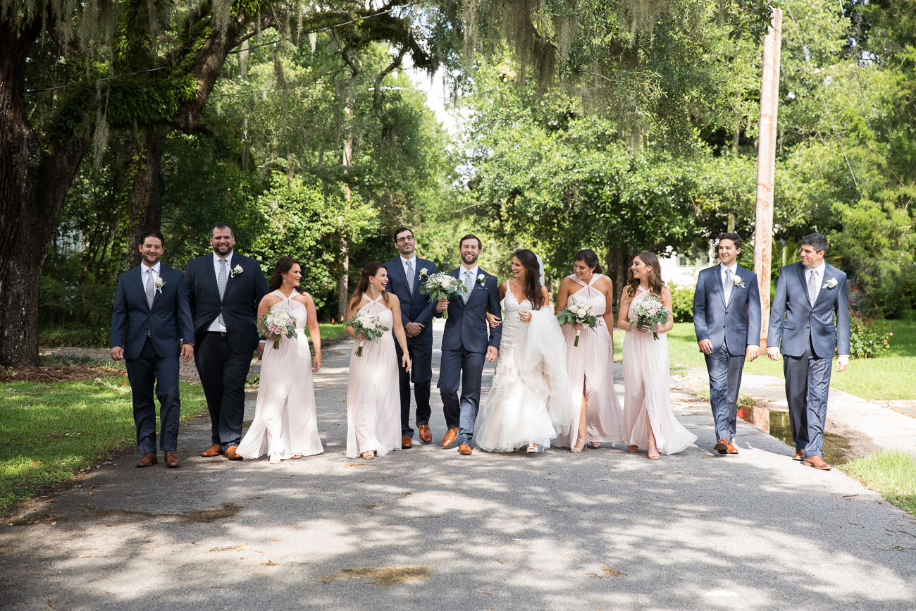 I loved the combo of blue suits with light blush gowns for Lauren and Kyle's wedding party!