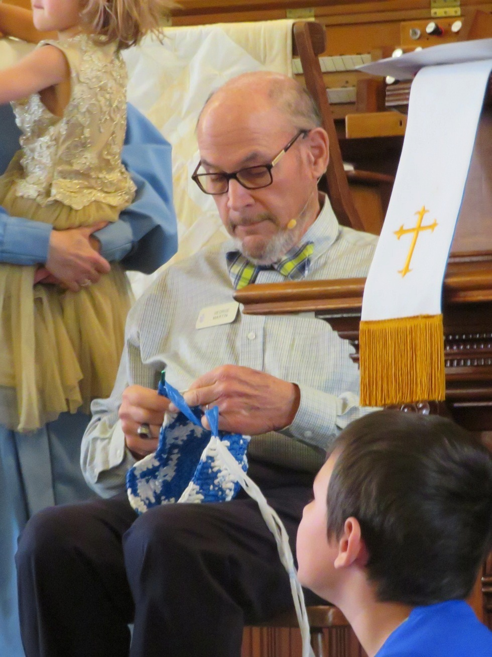 Single use becomes multi-use! - George Martin crochets strips of plastic he collects into bags that can be used again and again. Here he is in worship showing the kids his gifted fingers.