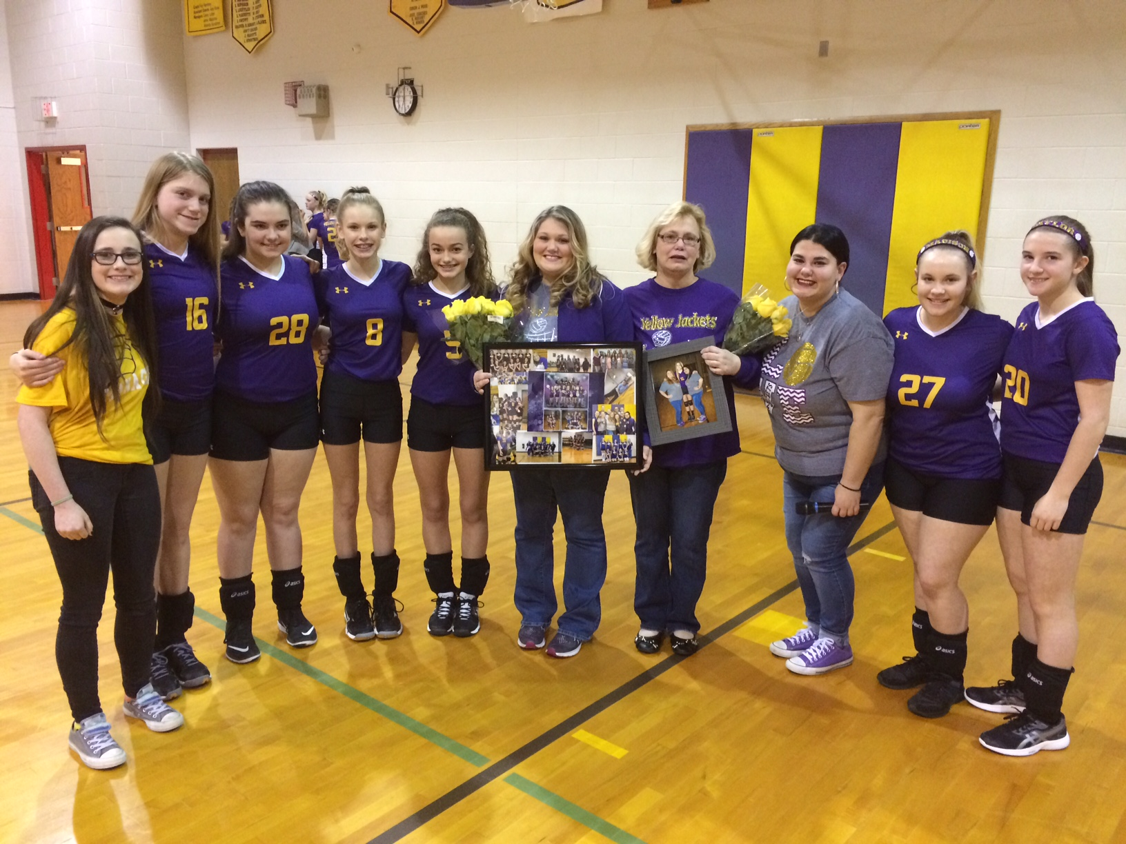 The 8th grade girls recognizing their coaches, Kristi Isaac and Patti Thompson