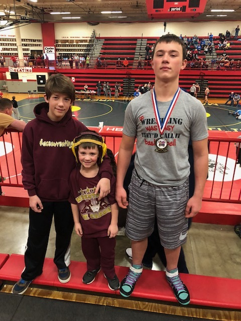Kenny Taylor (R) is shown with his brothers Hank and Satchel after advancing to the IKWF State Tournament.