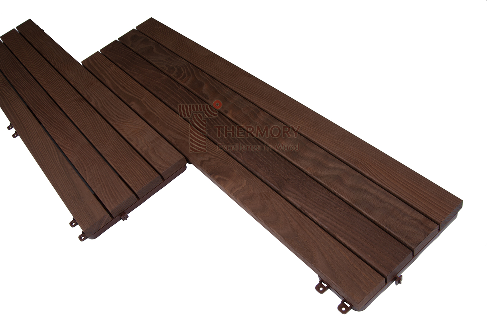 Quick Deck Maxi Slim - Building a deck doesn't have to be challenging and time-consuming. Thermory® QuickDeck® collection offers a wide range of pre-fabricated deck tiles which are easy to install.QuickDeck® comes in two different designs: Maxi & Mosaic.The simple click-system is suitable for installation on solid, flat surfaces, both interior and exterior.