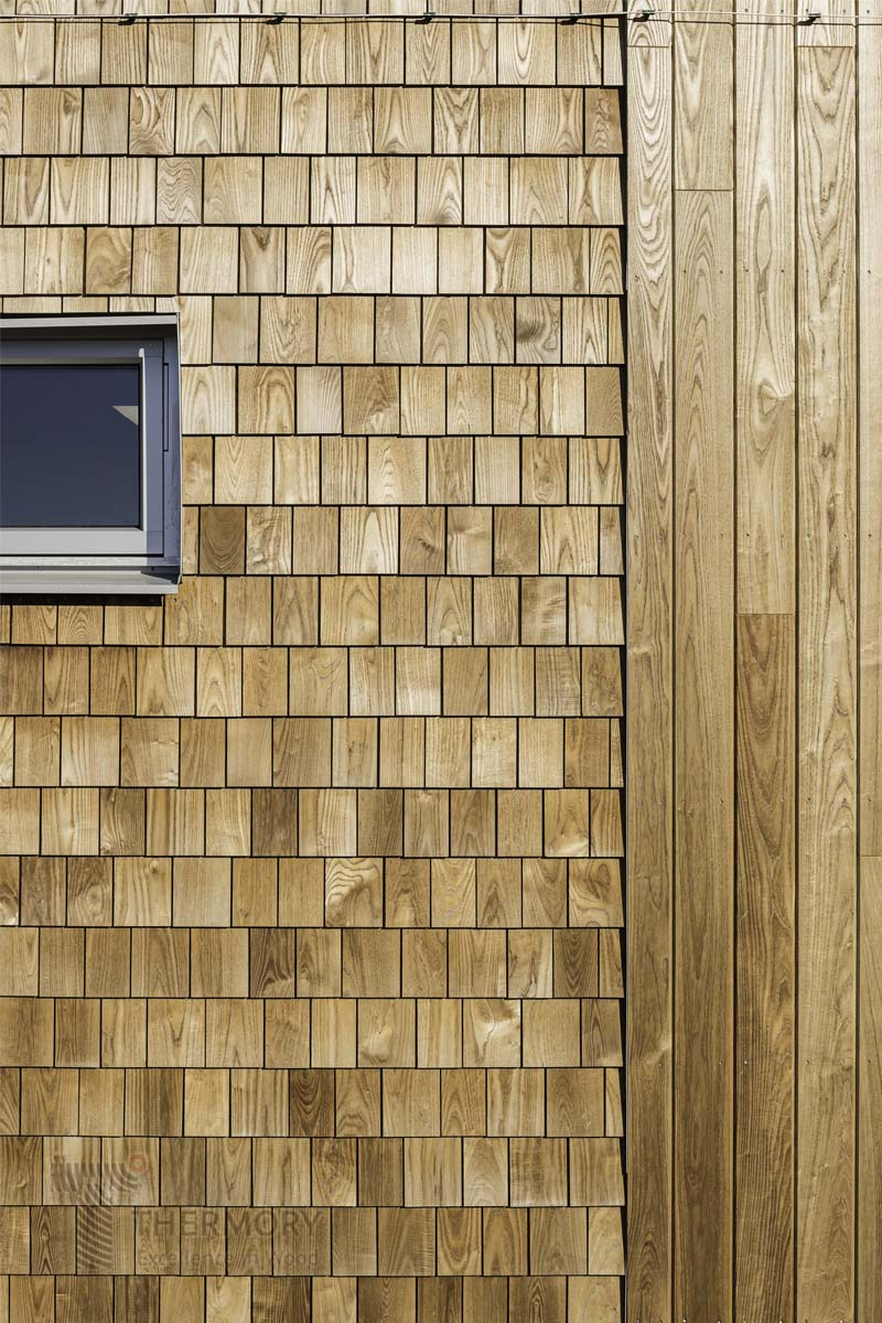 Thermory® Ash Shingles - The resawn surface and a vibrant texture add a trendy wallcovering to your interior and exterior design.The Thermory® intense modification increases dimensional stability and durability as well as bringing out the beauty of the natural wood grain. The warm rich tone of the Thermory® ash will gently turn to a stunning silver grey over time.The combination of the Thermory® paC-System® and shingle elements offers a superior solution for an eye-catching result with the easiest installation possible. The shingle elements can be pressed and clicked into place with ease. Profiles:S1Thickness: 4/10mmWidth: 90-150mmLength: 350mmS2-E paC-System®Element Thickness: 350mmElement Width: 90-150mmElement Length: 1250mm