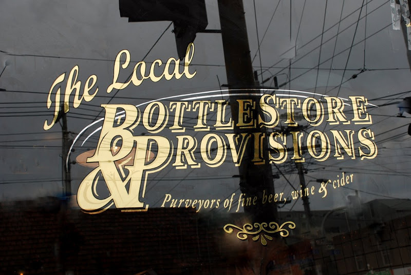 gold-leaf-gilded-window-signwriting-the-local-bottlestore-and-provisions.jpg