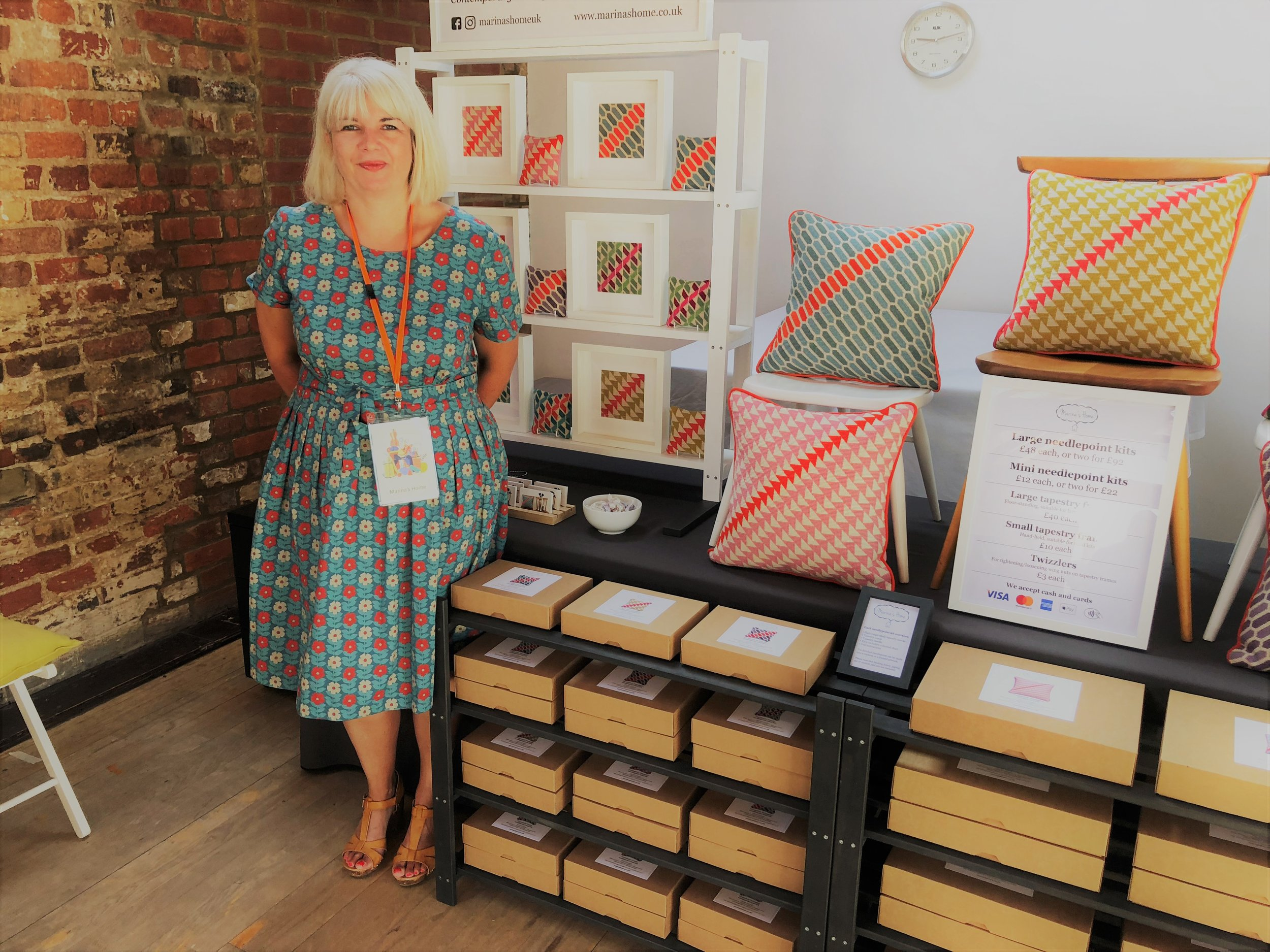 My friend Debbie (aka Skein Queen) - her outfit coordinated nicely with my blue and orange Geometric Hexagons design!