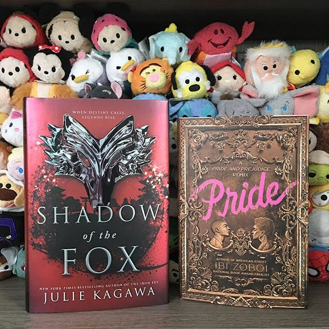Here are the two October @owlcrate books! Are they stunning or are they stunning?? I'm taking care of some errands and chores before my work trip next week, and I also need to decide which book to bring with me! I'll have a few nights to myself at the hotel so you know what that means- room service and reading time! 😛📚 - - - - - #bookshelf #bookstagram #bookworm #booklover #bookphoto #bookclub #book #books #bookblogger #bibliophile #yafantasy #pride #bettereads #booknerd #bookish #shadowofthefox #bookshelfie #bookmark #readmore #tsumtsum #owlcrate #igreads
