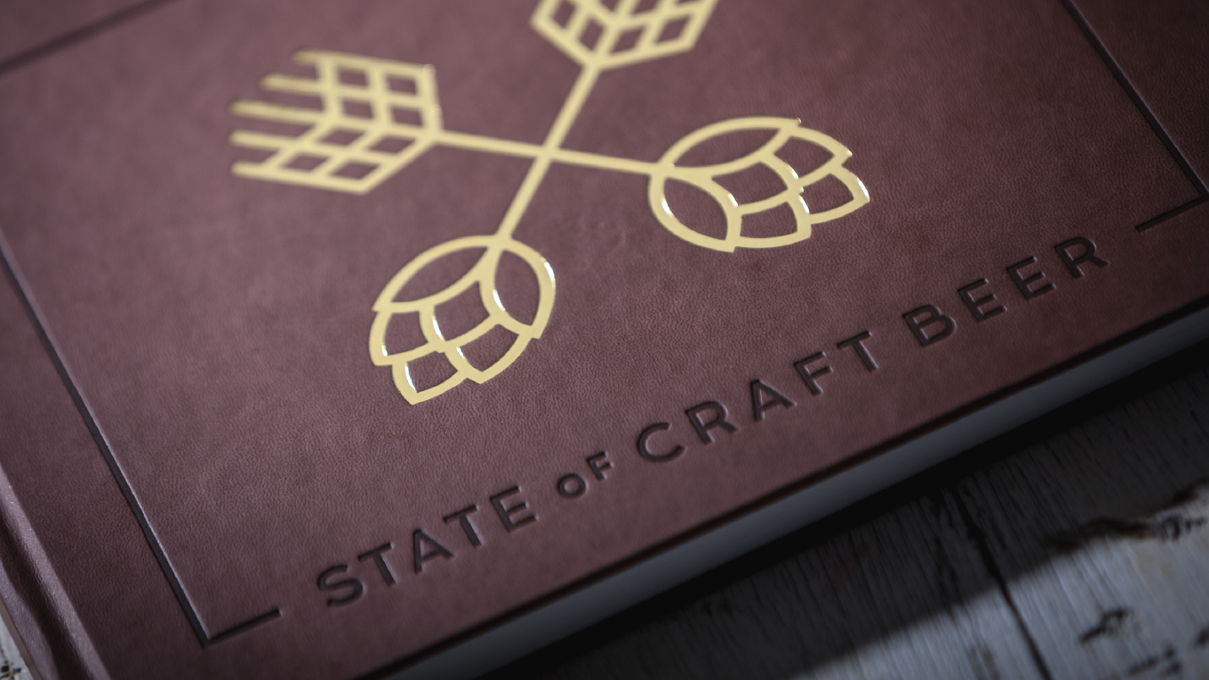 Hot-pressed and foil-stamped hardcover, hand-lettered typography