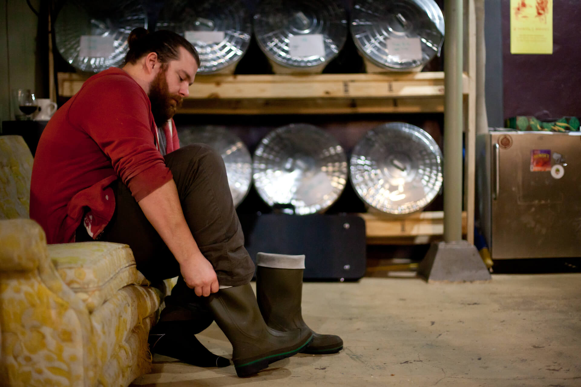Ryan Verdon gets ready to start his day at Real Deal Brewing (located in the basement of The Raw Deal, Menomonie)
