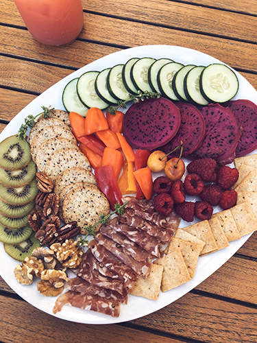 We love making meat and veggie plates! This is a fun and easy snack. All you need is a large plate, a sharp knife and any fresh fruit, veggies, meats, mixed nuts or cheeses.