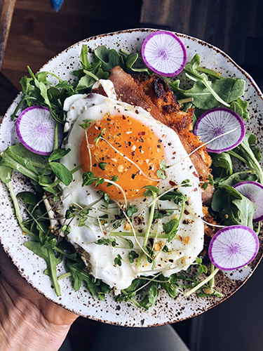 Using leftover sweet potato mash we made patties and fried them in avocado oil to make delicious little hash brown things. Topped it with an egg, radish and micro greens. So good!
