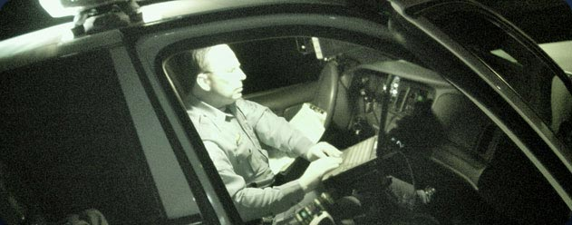 Officer in vehicle working on computer.jpg