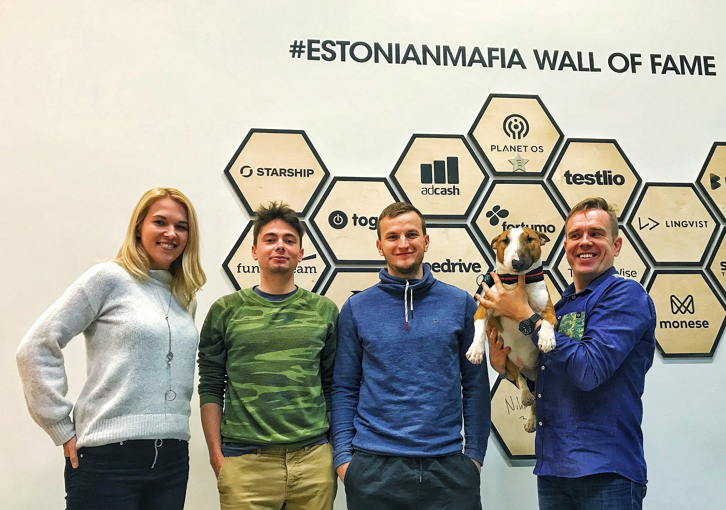 Annika, Taavi, Mikk, Rocky, and Ragnar at LIFT99, in front of #EstonianMafia Wall of Fame