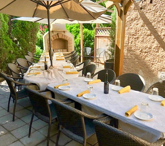 THE COURTYARD - Enjoy al fresco dining on our rustic courtyard patio surrounded by Tuscan blue rosemary, olive trees, beautiful potted plants, a gazebo, a fireplace and outdoor heaters. The courtyard can seat 12-50 people.