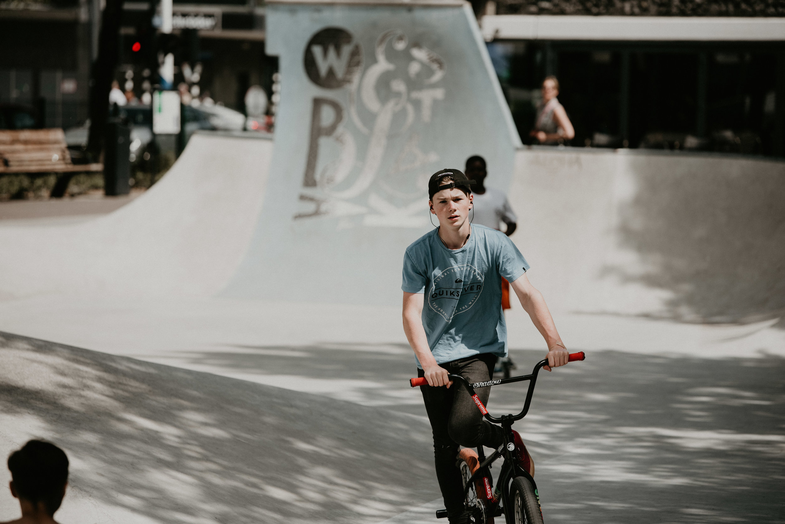 Teenage boy at the rotterdam skatepark on westblaak. He is riding a bmx bike