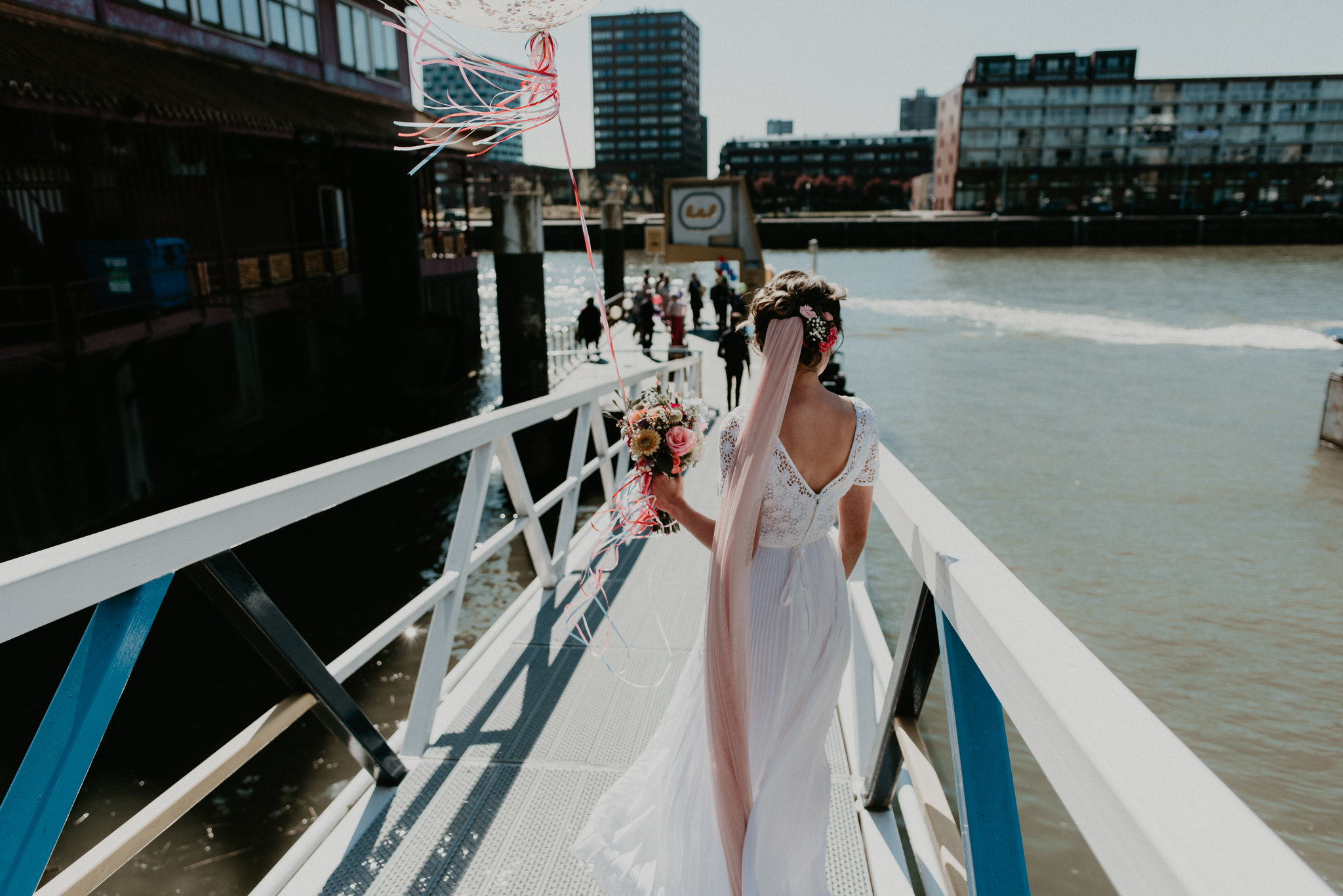 Bride walking to the Rotterdam water taxi on her wedding day