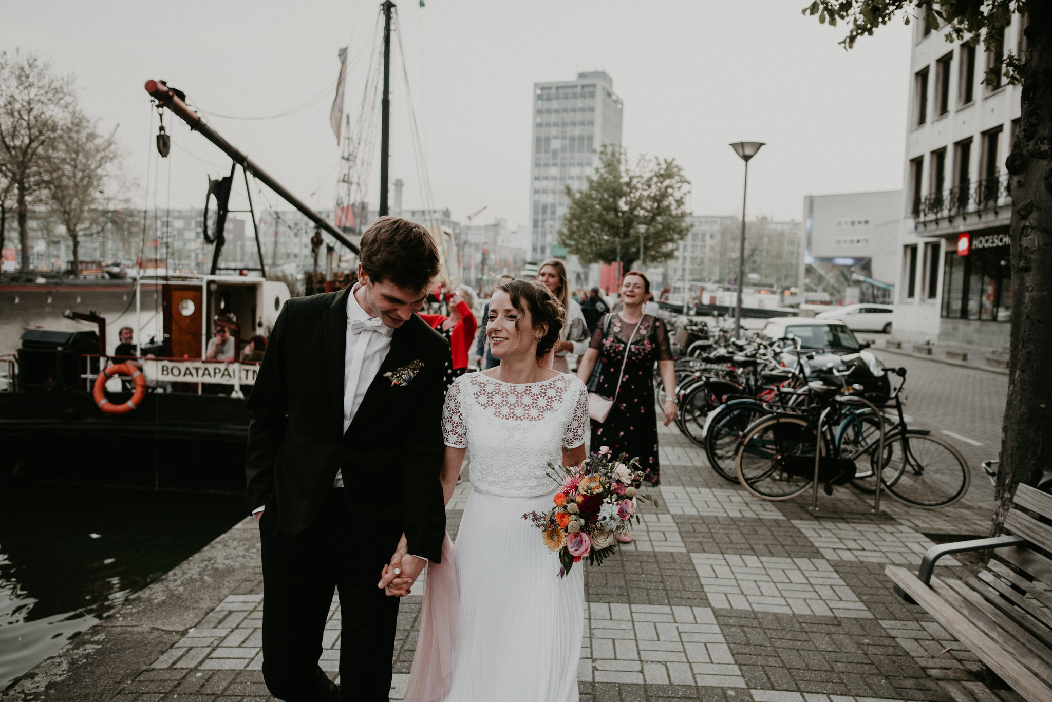 Bride and groom walking together in Rotterdam Oude Haven to Vessel 11