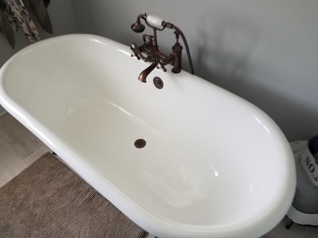 The oversized tub is delightful and so easy to relax in. The telephone style faucet hardware sticks with the farmhouse feel but there are more modern options if this isn't to your liking.