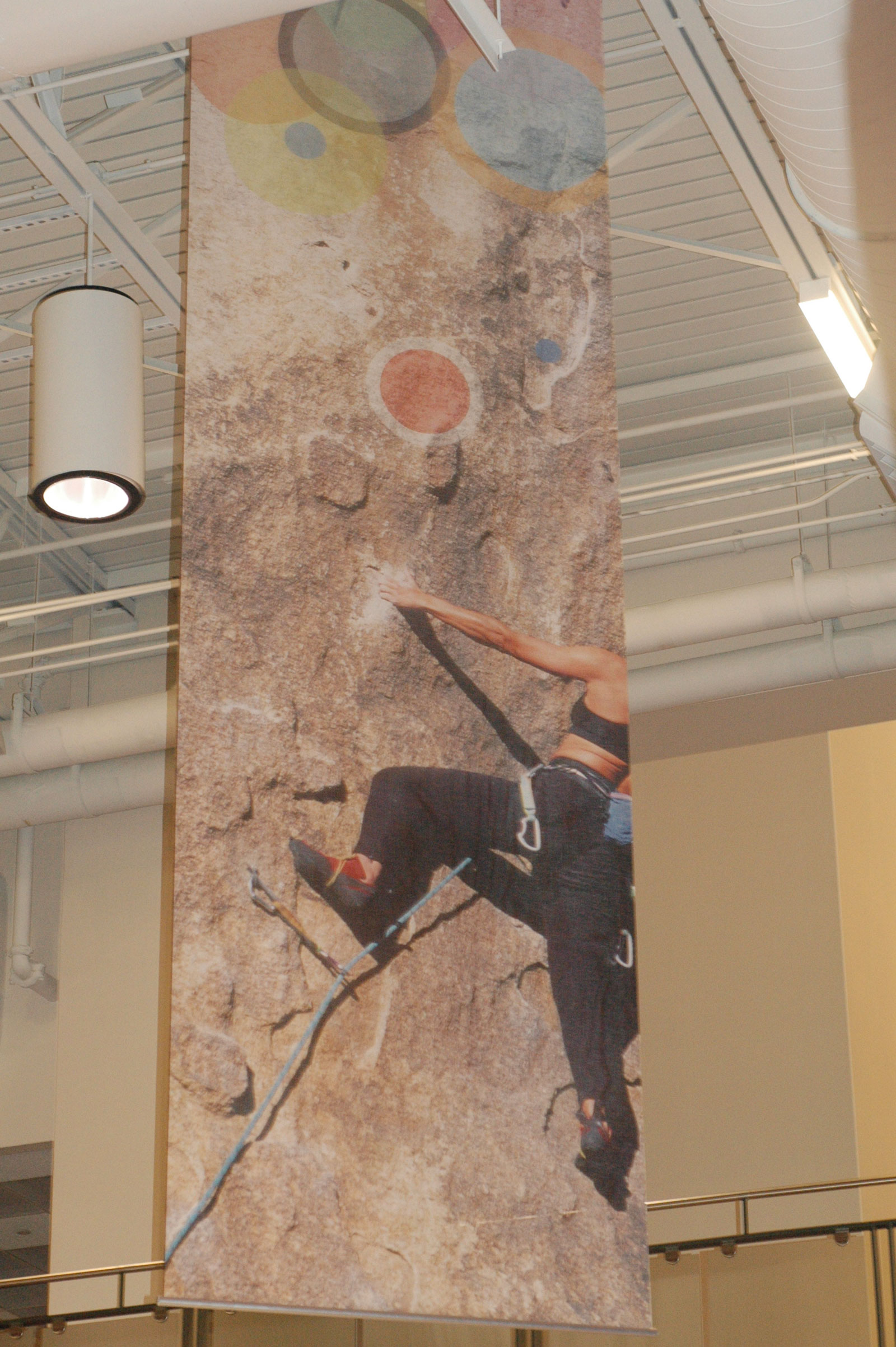 14' High Digital Printed Vinyl Banner on Mesh  Hung and supported by Stand Off Rods and Hardware