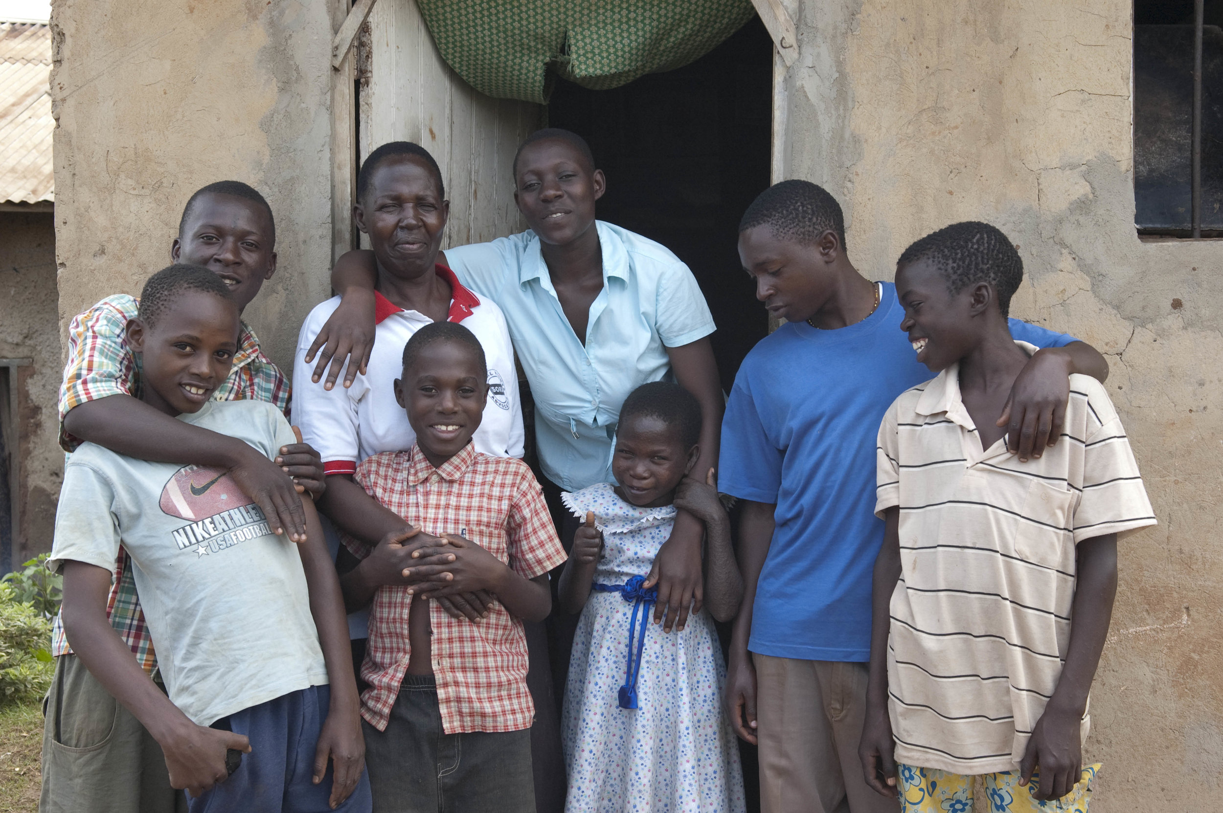 Regina and family outside their home 2010