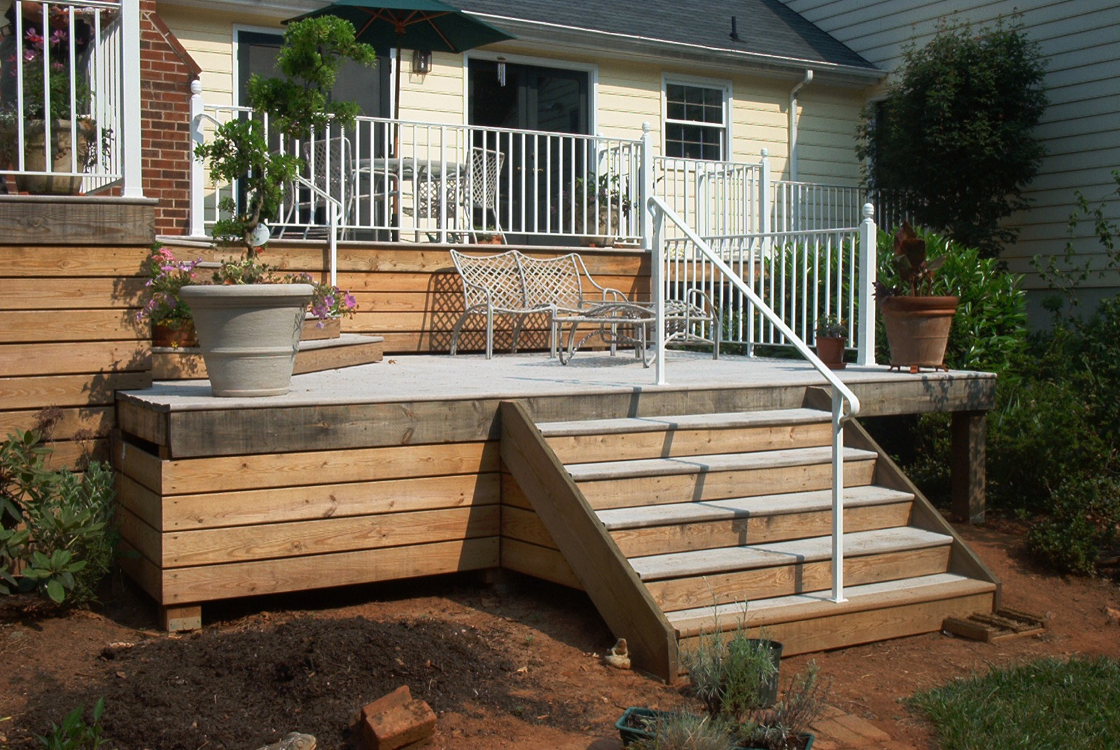 Ironlike deck rail with a combination of post styles