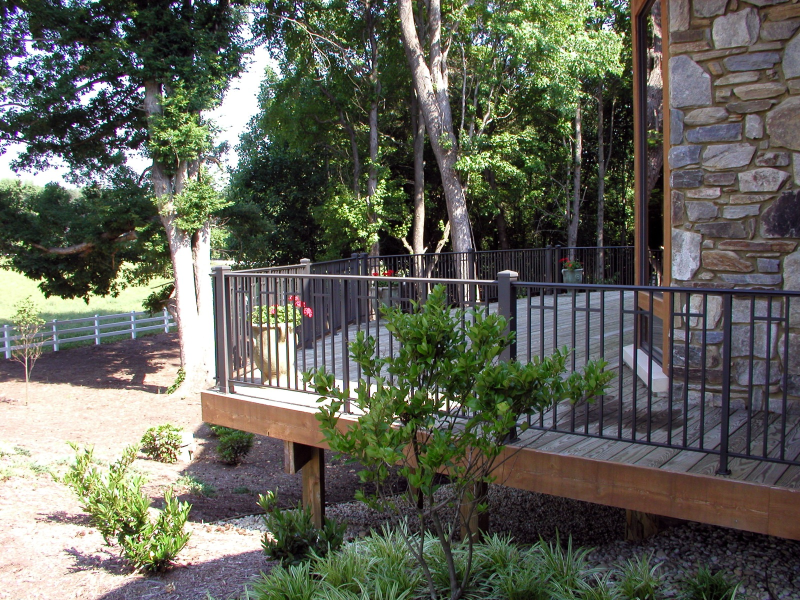 Ironlike deck rail with horizontal pickets in-between the vertical pickets. Both 3in. and 1.25in