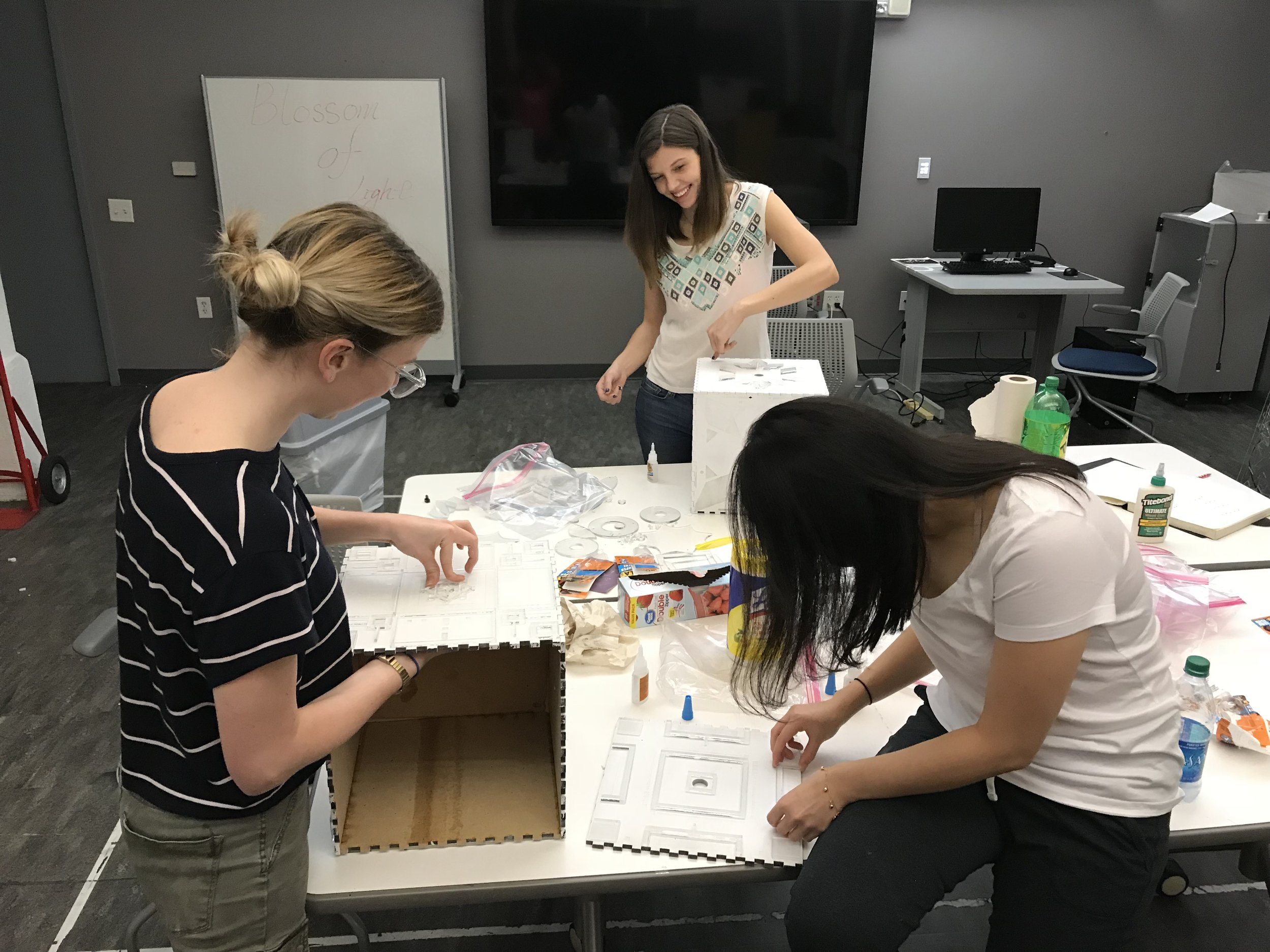 Gluing together the cubes and adding the acrylic details. Thanks Madison and Eleena for your hard work and helping hands!