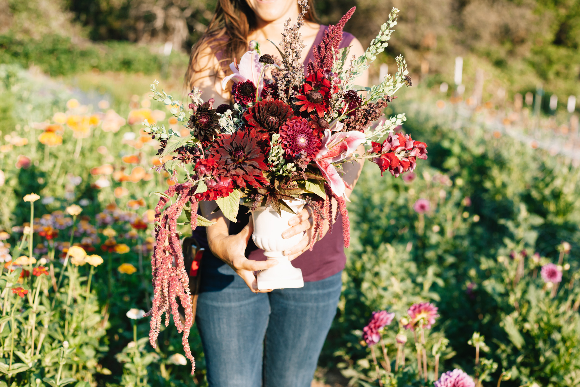And here I am with a centerpiece arrangement in the field near where these flowers were harvested.