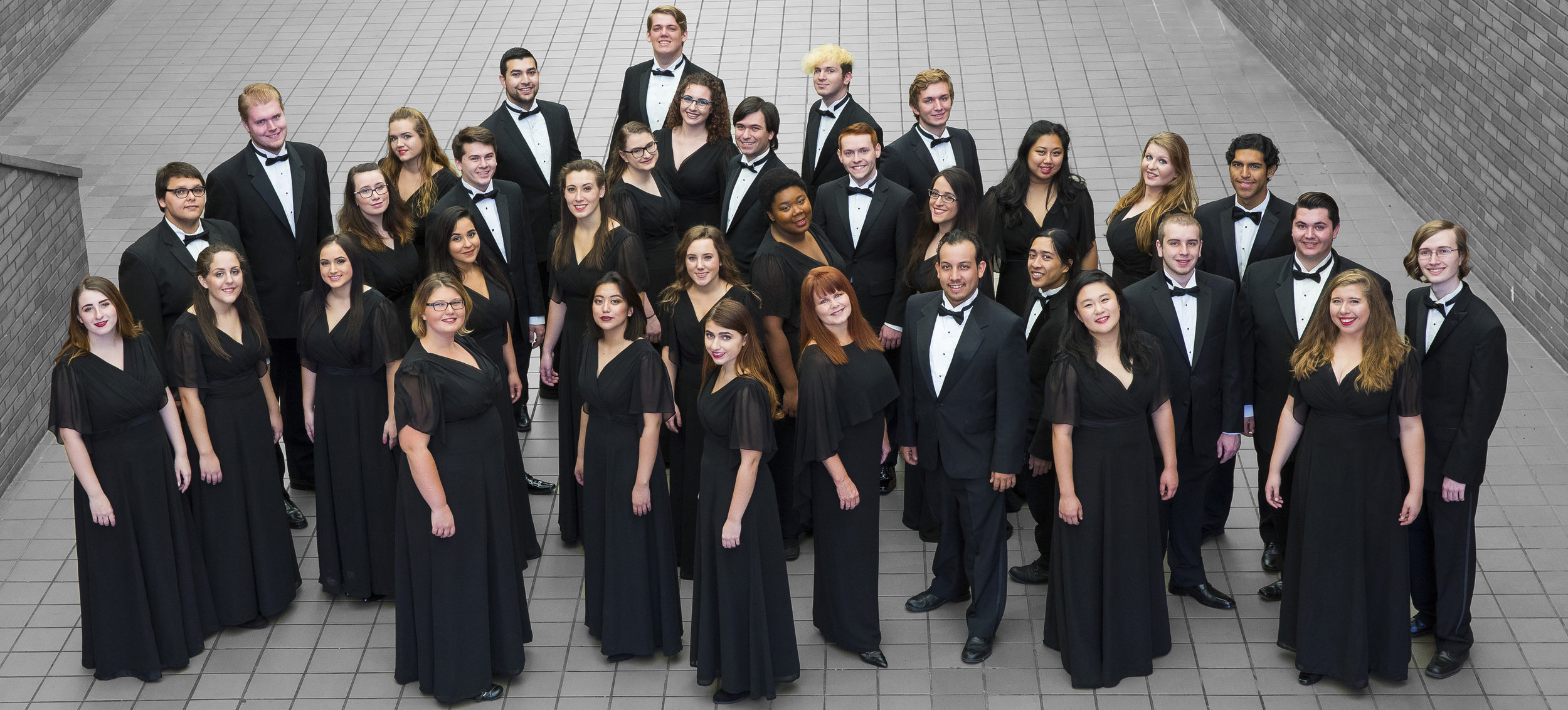 Chamber Choir - An auditioned mixed-voice ensemble that rehearses three times per week and focuses largely on a cappella works calling for tight ensemble precision.