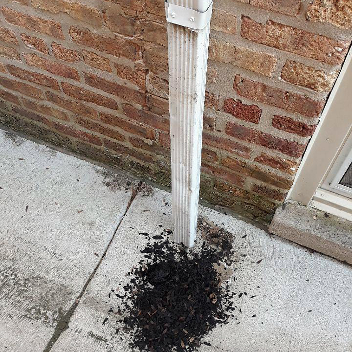 Chicago-Gutter-Cleaning-Downspout-Debris.jpg