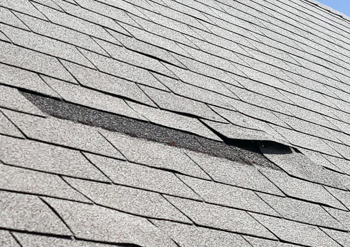 Guratanteed Gutters-missing-shingles-nail-popschicago-IL.jpg