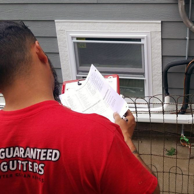Peter completing a FREE gutter inspection.