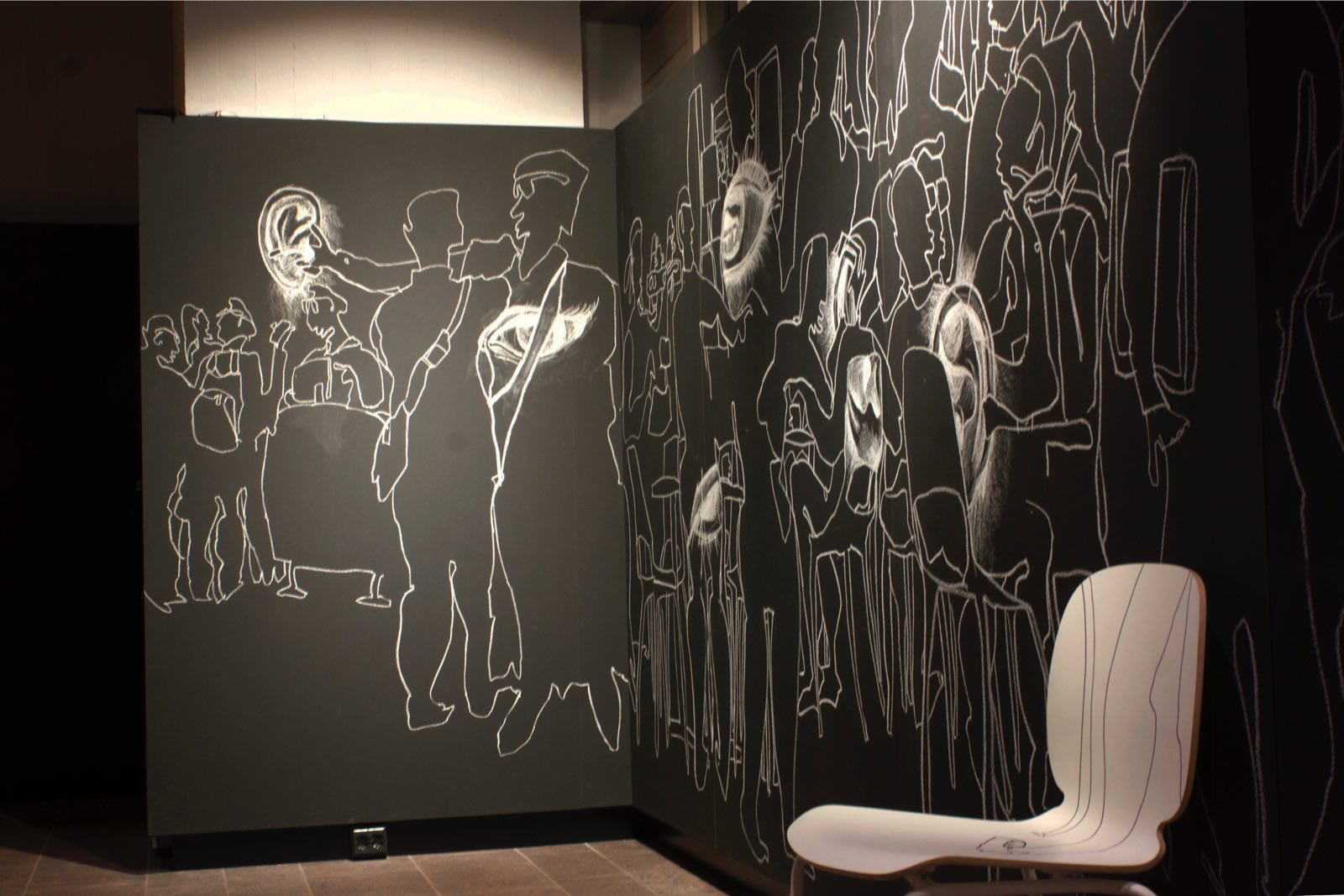 Chair   Connection happens everywhere. People connect with people , with objects, with their own feelings. A chair can be connected through human activity. Here, a white chair interacts with the wall drawing, illustrating the relationship between individuals and objects