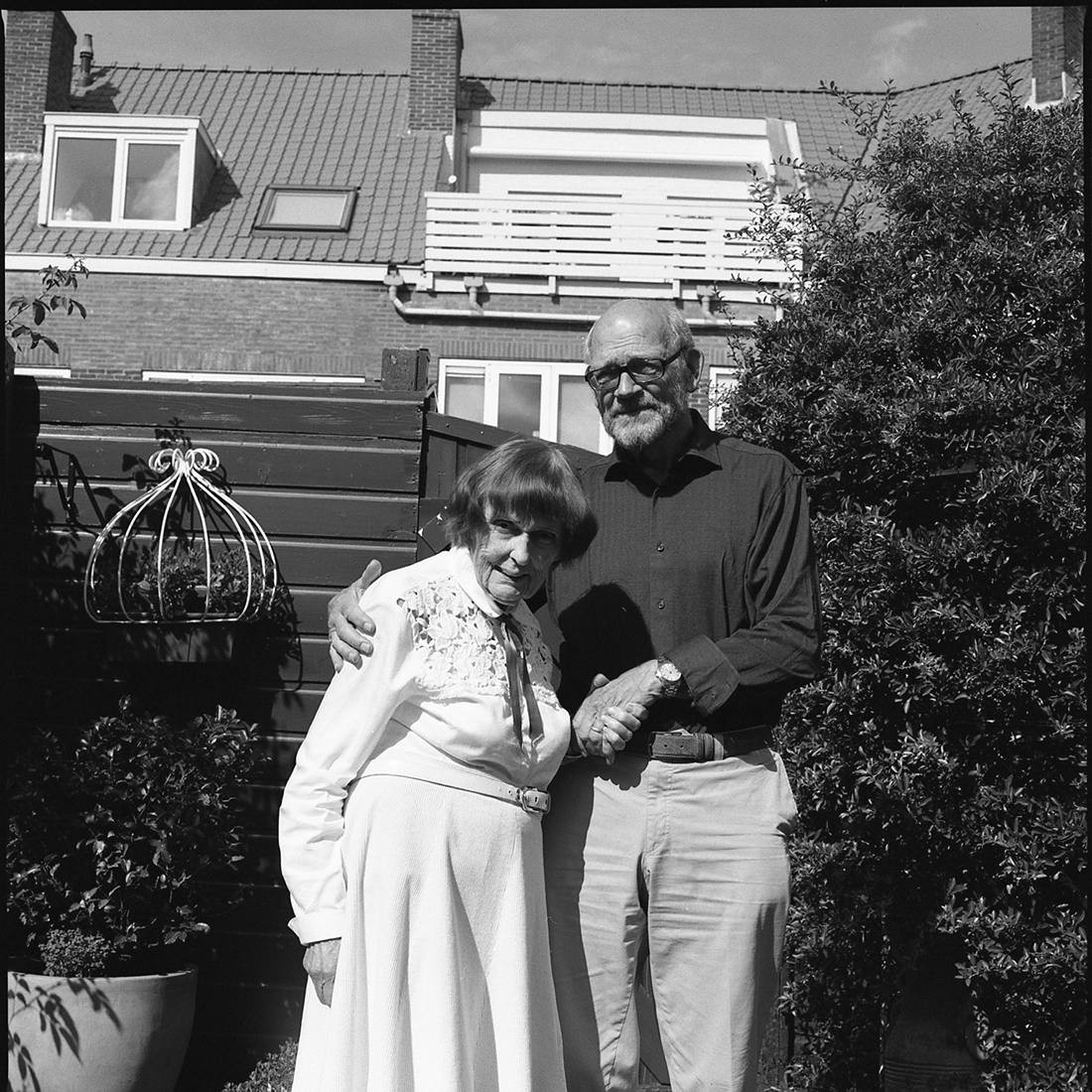 Grandma and grandpa posing in the backyard