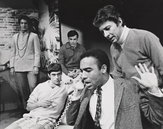 The original cast, recreating a dramatic moment