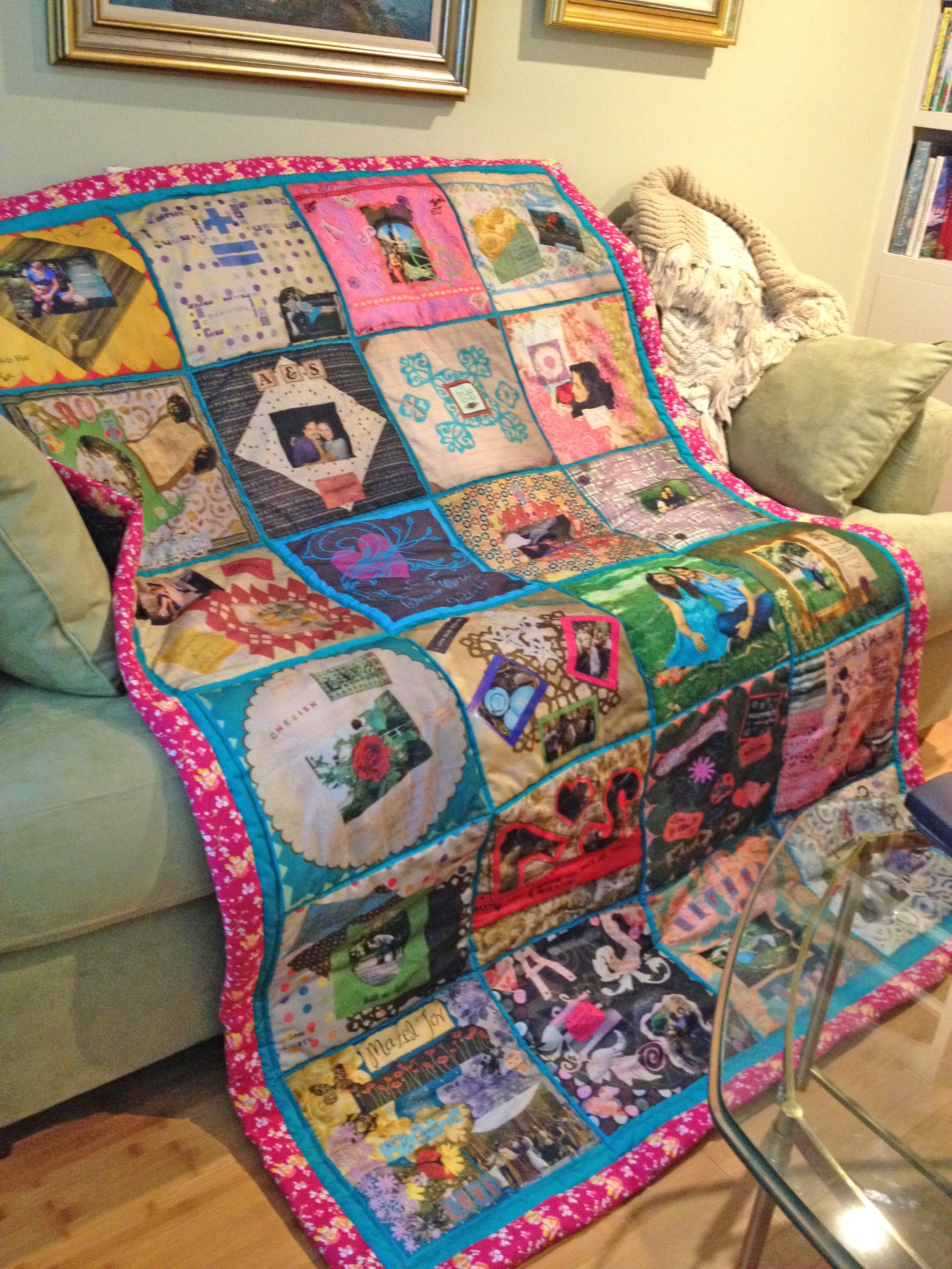 Wedding quilt made from paper squares made by guests at crafty scrapbooking bridal shower. Printed, stuffed and sewn.