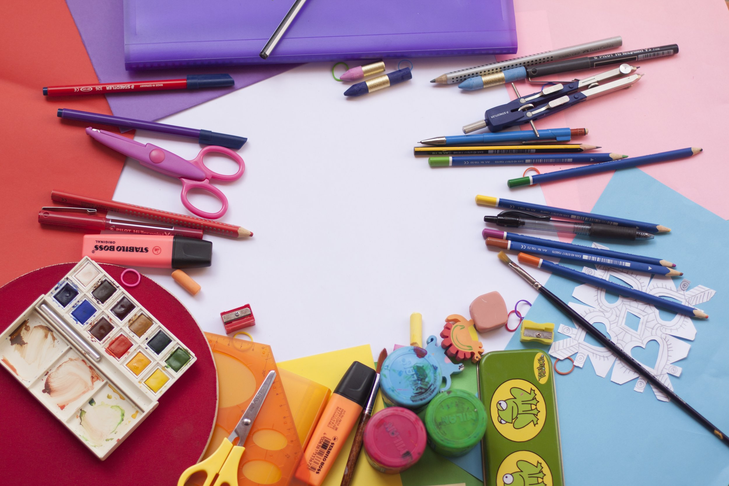 Paint brushes, paint, stamps and other art supplies in circle