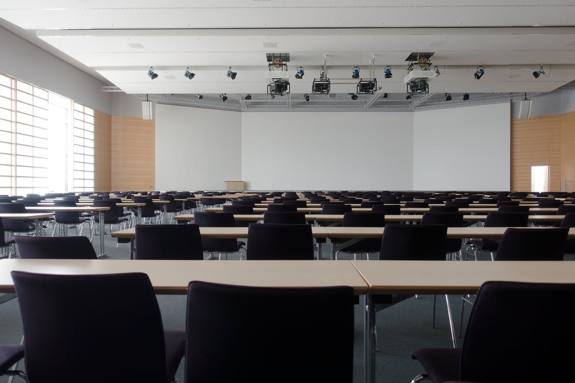 Conference room with rows of tables and chairs