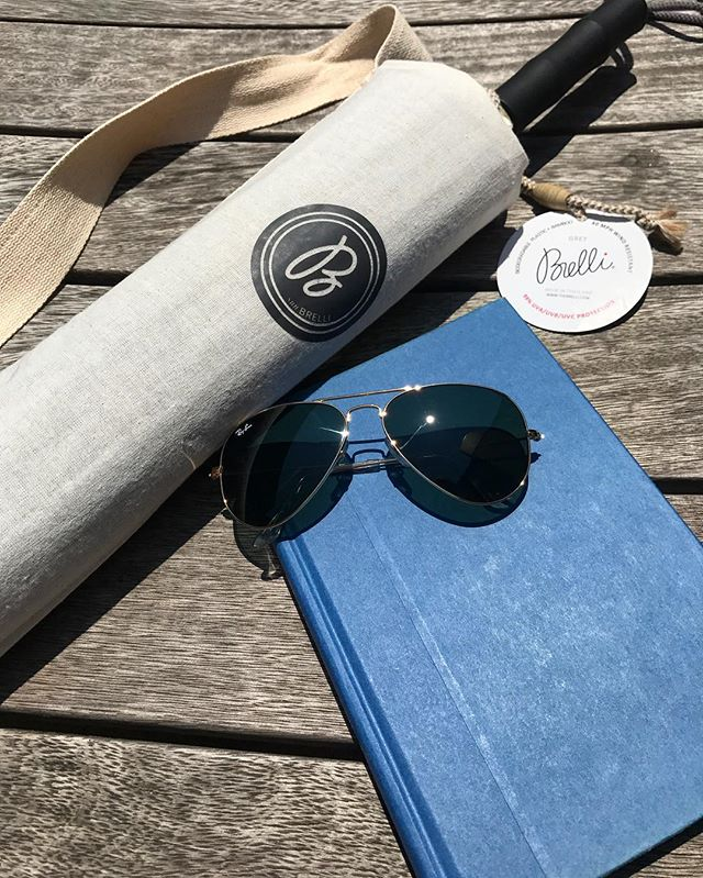 What are some of your favorite Summertime Accessories? ☀️ . . . . . . . . . . #summertime #sun #accessories #necessities #BRELLI #book #raybans #fashion #poolside